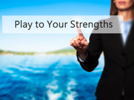 strongest: Play to Your Strengths - Businesswoman hand pressing button on touch screen interface. Business, technology, internet concept. Stock Photo