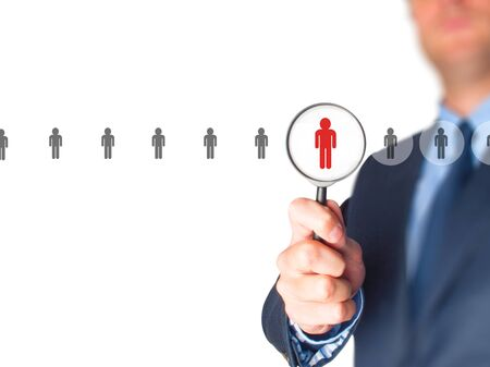 media center: Networking and recruitment - Businessman with magnifying glass. Human resources, CRM, data mining, assessment center and social media concept - officer looking for employee represented by icon. Stock Photo