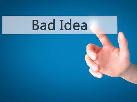 bad idea: Bad Idea - Hand pressing a button on blurred background concept . Business, technology, internet concept. Stock Photo Stock Photo