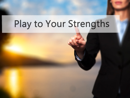 business leadership: Play to Your Strengths - Businesswoman hand pressing button on touch screen interface. Business, technology, internet concept. Stock Photo