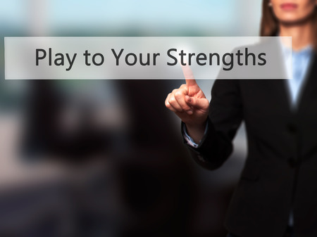 strongest: Play to Your Strengths - Businesswoman hand pressing button on touch screen interface. Stock Photo