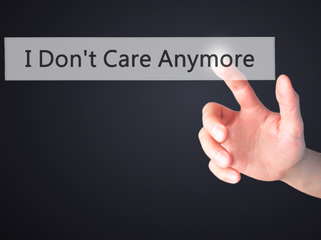 don't care: I Dont Care Anymore - Hand pressing a button on blurred background concept