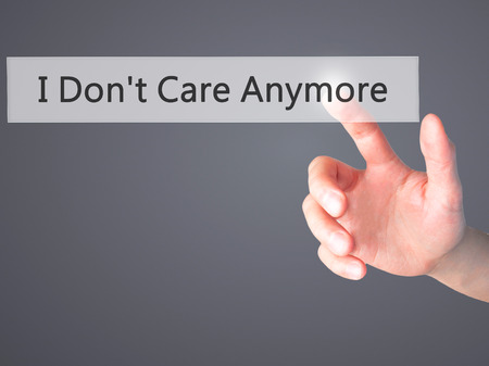 don't care: I Dont Care Anymore - Hand pressing a button on blurred background
