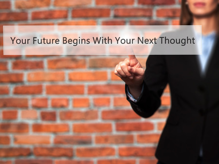 crecimiento personal: Your Future Begins With Your Next Thought - Businesswoman hand pressing button on touch screen interface. Business, technology, internet concept. Stock Photo