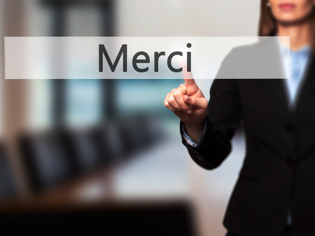acknowledgment: Merci - Businesswoman hand pressing button on touch screen interface. Business, technology, internet concept. Stock Photo
