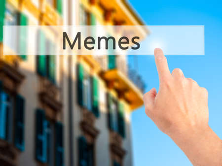 trolling: Memes - Hand pressing a button on blurred background concept . Business, technology, internet concept. Stock Photo Stock Photo