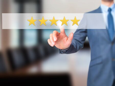 restaurant rating: Five star rating - Businessman hand pressing button on touch screen interface. Business, technology, internet concept. Stock Photo Stock Photo