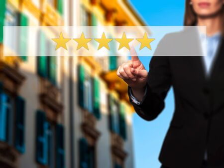 five star: Five star rating - Businesswoman hand pressing button on touch screen interface. Business, technology, internet concept. Stock Photo