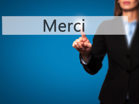 Merci - Businesswoman hand pressing button on touch screen interface. Business, technology, internet concept. Stock Photo