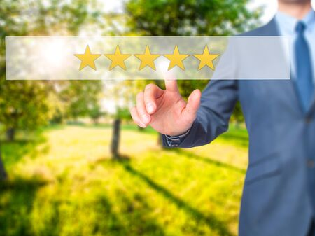 five star: Five star rating - Businessman hand pressing button on touch screen interface. Business, technology, internet concept. Stock Photo Stock Photo