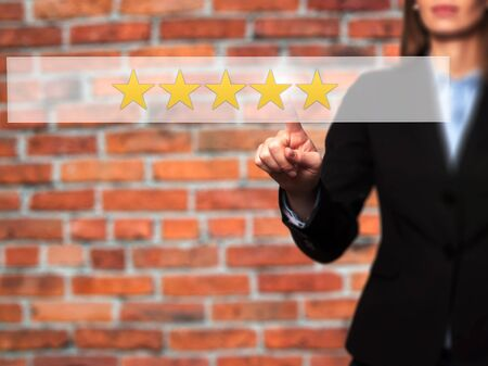 restaurant rating: Five star rating - Businesswoman hand pressing button on touch screen interface. Business, technology, internet concept. Stock Photo