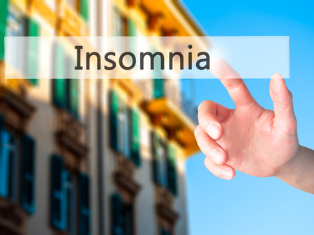 insomniac: Insomnia - Hand pressing a button on blurred background concept . Business, technology, internet concept. Stock Photo