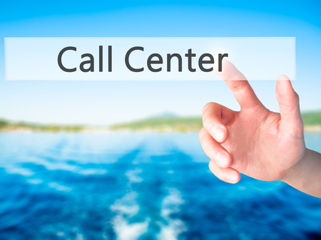 criticize: Call Center - Hand pressing a button on blurred background concept . Business, technology, internet concept. Stock Photo