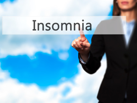 insomniac: Insomnia - Businesswoman hand pressing button on touch screen interface. Business, technology, internet concept. Stock Photo Stock Photo