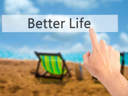 better button: Better Life - Hand pressing a button on blurred background concept . Business, technology, internet concept. Stock Photo