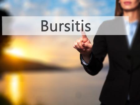 Bursitis - Businesswoman hand pressing button on touch screen interface. Business, technology, internet concept. Stock Photo Stok Fotoğraf