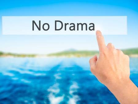 No Drama - Hand pressing a button on blurred background concept . Business, technology, internet concept. Stock Photo Stock Photo