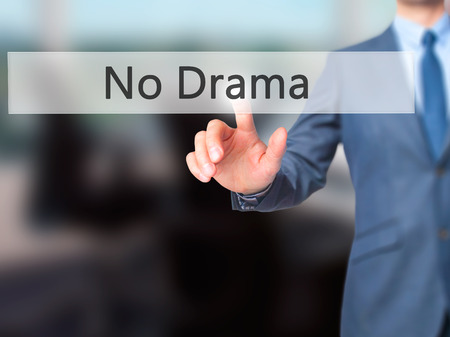 dramatic characters: No Drama - Businessman hand pressing button on touch screen interface. Business, technology, internet concept. Stock Photo