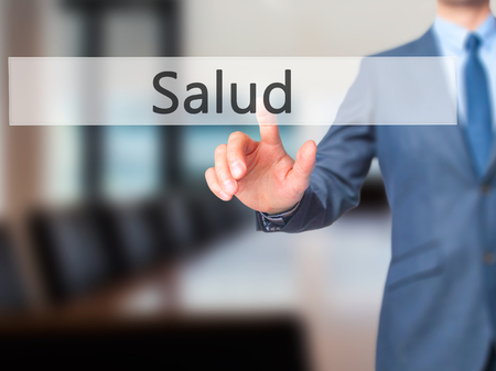 Salud - Businessman hand pressing button on touch screen interface. Business, technology, internet concept. Stock Photo Stock Photo