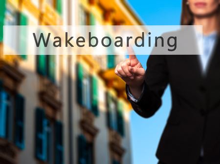 wakeboarding: Wakeboarding - Businesswoman hand pressing button on touch screen interface. Business, technology, internet concept. Stock Photo