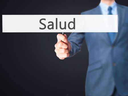 Salud - Businessman hand holding sign. Business, technology, internet concept. Stock Photo