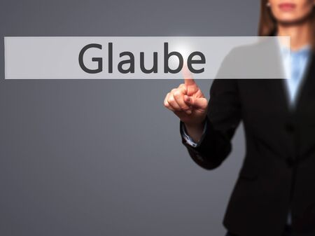 glaube: Glaube - Businesswoman hand pressing button on touch screen interface. Business, technology, internet concept. Stock Photo Stock Photo
