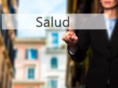 Salud - Businesswoman hand pressing button on touch screen interface. Business, technology, internet concept. Stock Photo