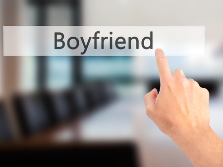 heartbreak issues: Boyfriend - Hand pressing a button on blurred background concept . Business, technology, internet concept. Stock Photo