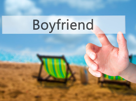 desertion: Boyfriend - Hand pressing a button on blurred background concept . Business, technology, internet concept. Stock Photo