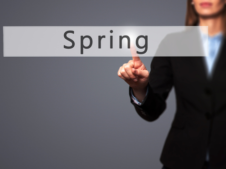 springbreak: Spring - Businesswoman hand pressing button on touch screen interface. Business, technology, internet concept. Stock Photo
