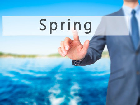 springbreak: Spring - Businessman hand pressing button on touch screen interface. Business, technology, internet concept. Stock Photo Stock Photo