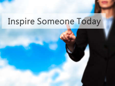 someone: Inspire Someone Today - Businesswoman hand pressing button on touch screen interface. Business, technology, internet concept. Stock Photo