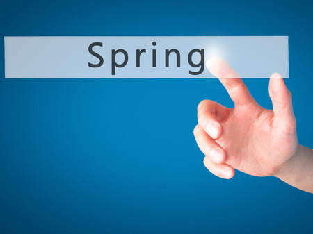 springbreak: Spring - Hand pressing a button on blurred background concept . Business, technology, internet concept. Stock Photo