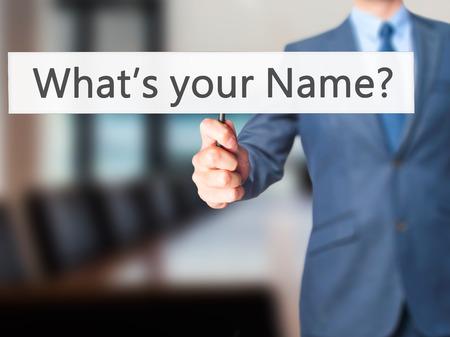 personality development: Whats your Name - Businessman hand holding sign. Business, technology, internet concept. Stock Photo
