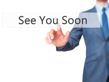 See You Soon - Businessman hand pressing button on touch screen interface. Business, technology, internet concept. Stock Photo