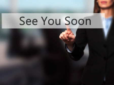 See You Soon - Businesswoman hand pressing button on touch screen interface. Business, technology, internet concept. Stock Photo