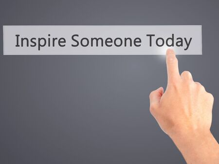 someone: Inspire Someone Today - Hand pressing a button on blurred background concept . Business, technology, internet concept. Stock Photo