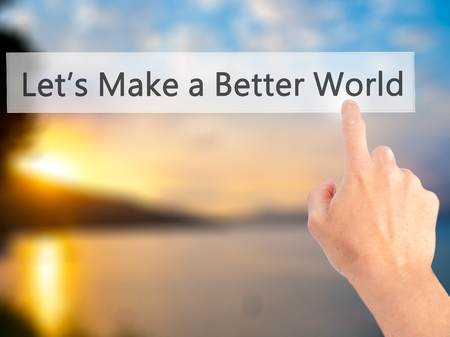 protestors: Lets Make a Better World  - Hand pressing a button on blurred background concept . Business, technology, internet concept. Stock Photo