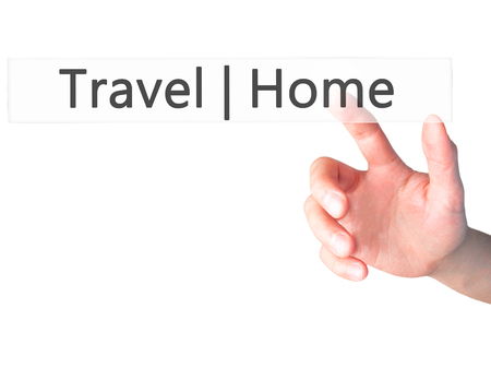 stay home work: Travel  Home - Hand pressing a button on blurred background concept . Business, technology, internet concept. Stock Photo