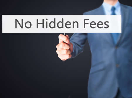 hidden costs: No Hidden Fees - Businessman hand holding sign. Business, technology, internet concept. Stock Photo