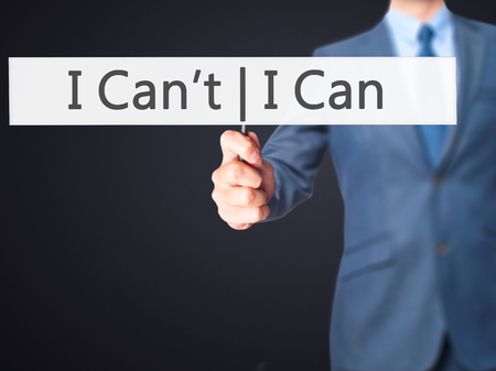 can't: I Can I Cant - Businessman hand holding sign. Business, technology, internet concept. Stock Photo