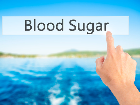 hyperglycemia: Blood Sugar - Hand pressing a button on blurred background concept . Business, technology, internet concept. Stock Photo