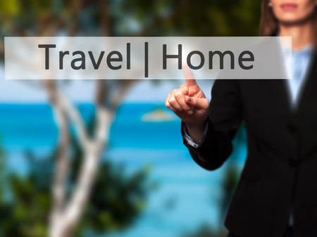 stay home work: Travel  Home - Businesswoman hand pressing button on touch screen interface. Business, technology, internet concept. Stock Photo