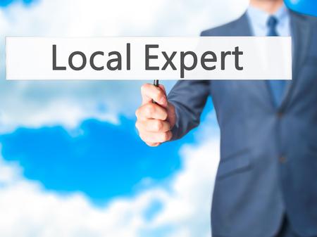 proficient: Local Expert - Businessman hand holding sign. Business, technology, internet concept. Stock Photo