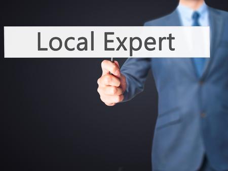 skillset: Local Expert - Businessman hand holding sign. Business, technology, internet concept. Stock Photo