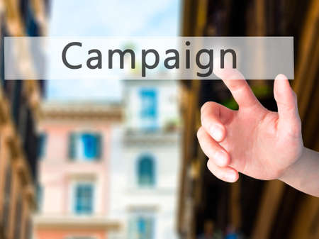 strategic focus: Campaign - Hand pressing a button on blurred background concept . Business, technology, internet concept. Stock Photo