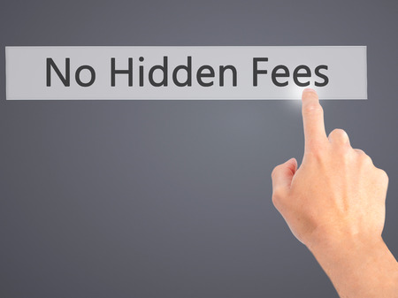 hidden taxes: No Hidden Fees - Hand pressing a button on blurred background concept . Business, technology, internet concept. Stock Photo