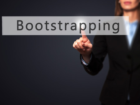 bootstrap: Bootstrapping - Businesswoman hand pressing button on touch screen interface. Business, technology, internet concept. Stock Photo