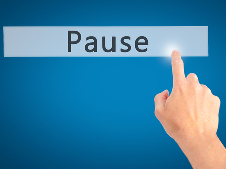 Pause - Hand pressing a button on blurred background concept . Business, technology, internet concept. Stock Photo