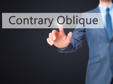 contrary: Contrary - Oblique - Businessman hand pressing button on touch screen interface. Business, technology, internet concept. Stock Photo